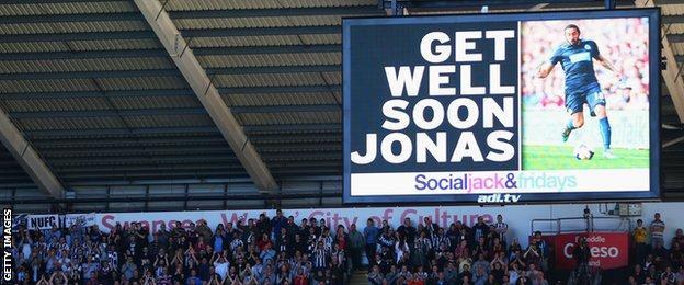 Swansea's scoreboard displays a message for Newcastle's Jonas Gutierrez