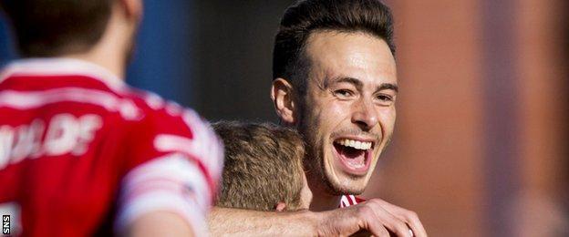 Andrew Considine celebrates after opening the scoring