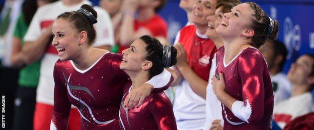 Hannah Whelan, Claudia Fragapane and Ruby Harold celebrate a 1-2-3 finish in the all round competition at the Commonwealth Games