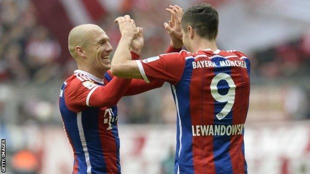 Arjen Robben and Robert Lewandowski celebrate
