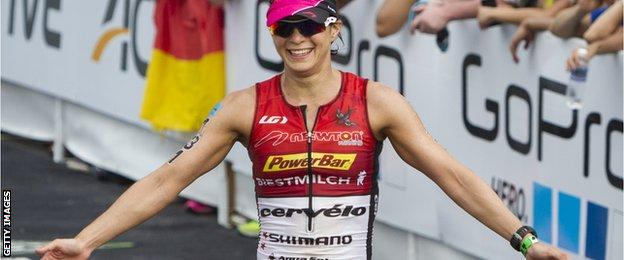 Rachel Joyce celebrates after finishing second in the 2013 Ironman World Championships