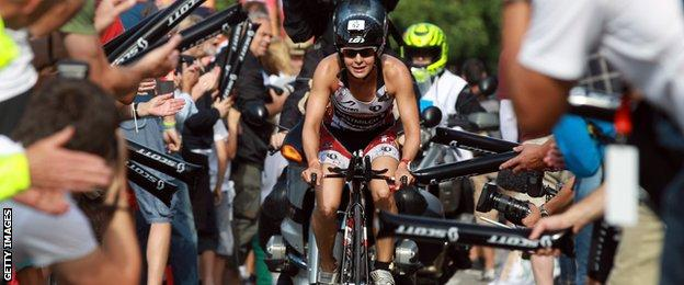 Fans cheer for Rachel Joyce as she cycles in the Challenge Roth triathlon