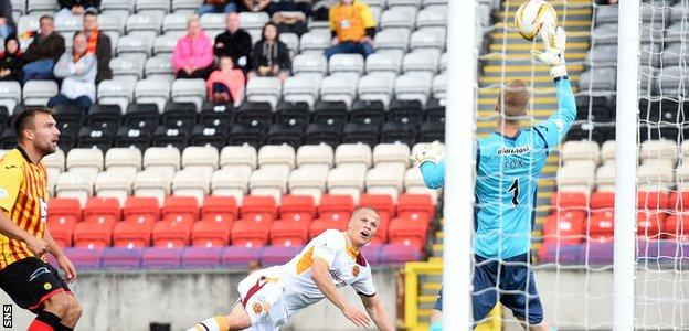 Motherwell's Henrik Ojamaa nods the ball against the bar with his side's best first-half chance