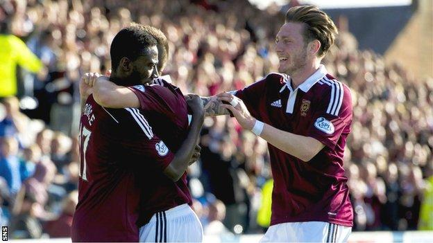The Hearts players congratulate Prince Buaben on scoring the team's second