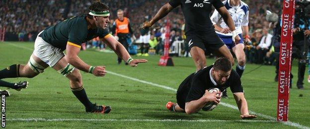 New Zealand's Dane Coles scores against South Africa