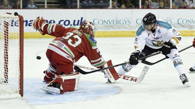 Devils netminder Ben Bowns can't keep out Ray Sawada's shot which put the Giants ahead