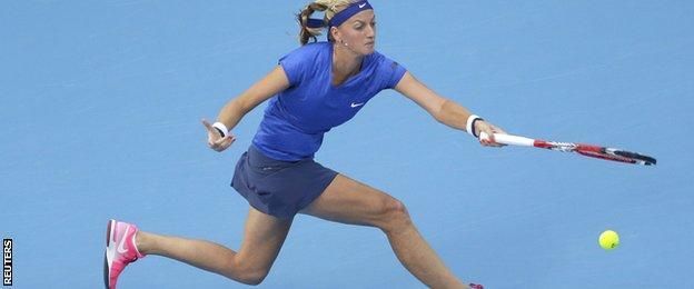 Petra Kvitova reaches for a forehand against Maria Sharapova
