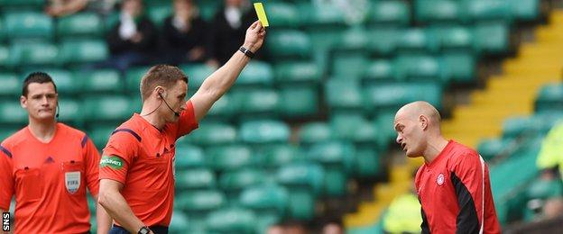 Hamilton Academical player-manager Alex Neil is booked by referee Steven McLean