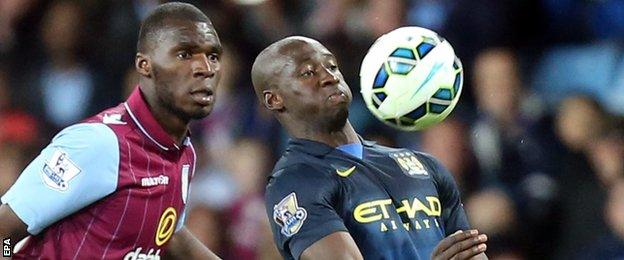 Manchester City defender Eliaquim Mangala (right)