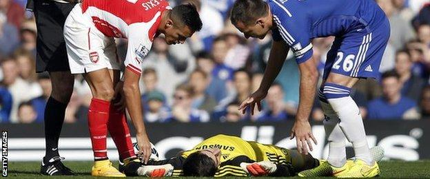 Chelsea's Thibaut Courtois left the pitch with a head injury after a collision with Alexis Sanchez
