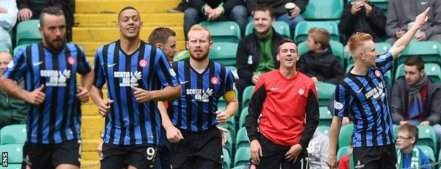 Ali Crawford (right) celebrates with his Accies teammates after scoring the winner against Celtic