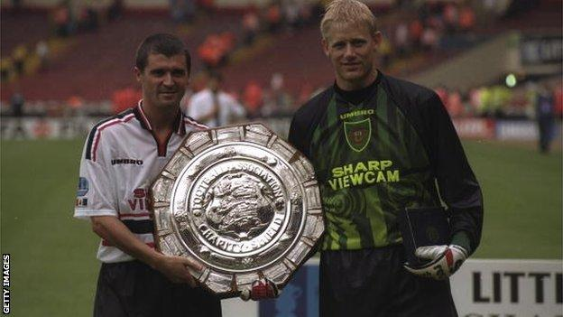 Roy Keane and Peter Schmeichel with the Charity Shield