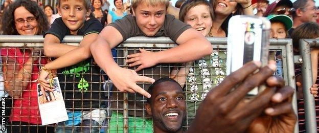 Justin Gatlin takes a selfie with fans after winning at this year's Diamond league meeting in Lausanne, Switzerland