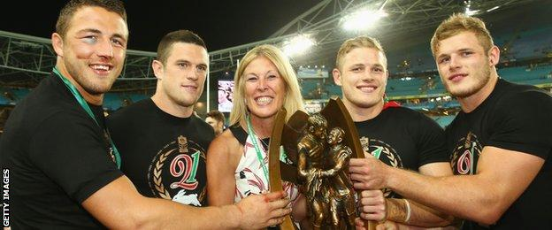The four Burgess brothers and mother Julie celebrate South Sydney's NRL Grand Final win on Sunday