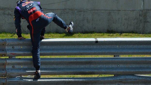 sebastian vettel jumps the Armco barrier at Silverstone