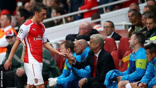 Mesut Ozil and Arsenal manager Arsene Wenger