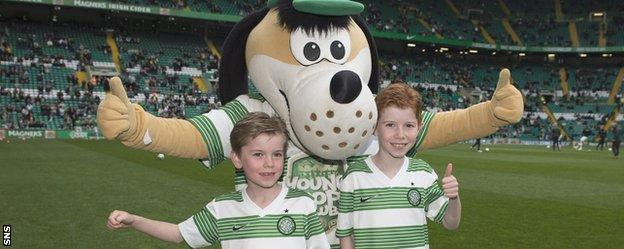 Celtic fans with the club's mascot