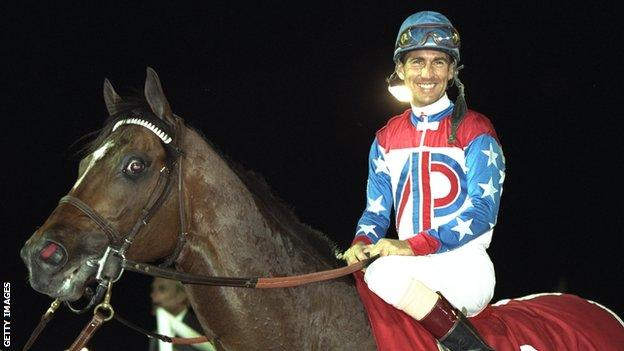 Gerry Bailey of the USA on Cigar celebrates winning the Dubai World Cup in 1996