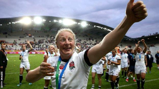 Sophie Hemming waves to the Paris crowd after England's World Cup win