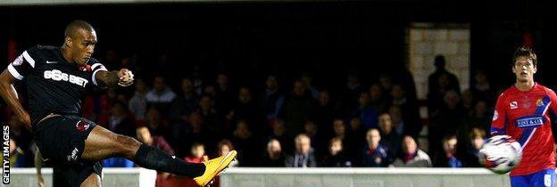 Jay Simpson scores against Dagenham in the Johnstone's Paint Trophy
