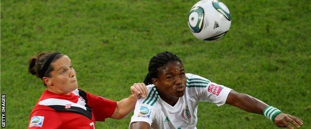 Nigeria's forward Desire Oparanozie (right) in action at the 2011 Women's world Cup