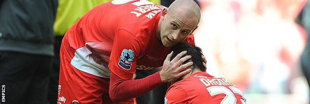 Scott Cuthbert comforts Chris Dagnall after Leyton Orient's play-off defeat at Wembley in May