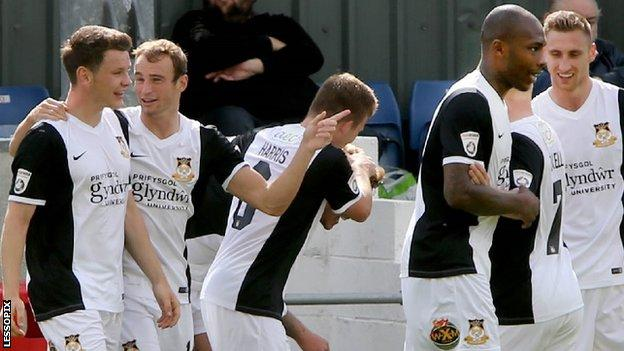 Wrexham players celebrate a goal against Alfreton this season