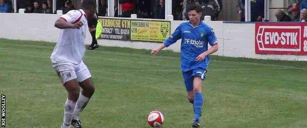 Joe Woolley playing for his new club, Market Drayton Town