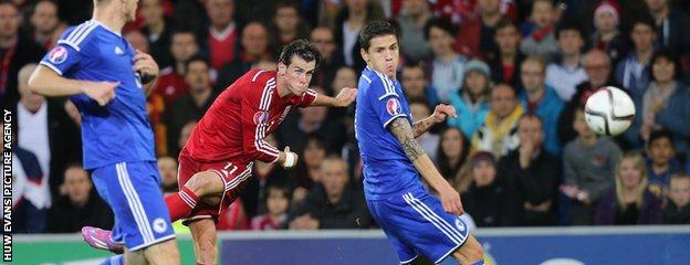 Wales' Gareth Bale fires a shot at goal