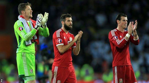 Wales players Wayne Hennessey, Joe Ledley and Gareth Bale applaud the fans