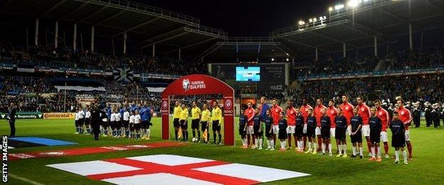 England and Estonia line up for the national anthems