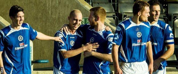 Stranraer's Jamie Longworth (second left) is congratulated on opening the scoring with a minute to go in the first half