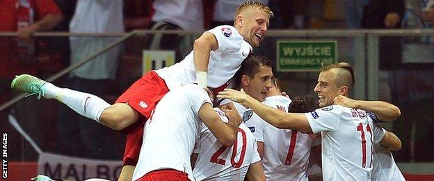 Poland celebrate scoring against Germany