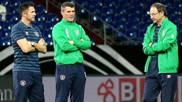 Republic captain Robbie Keane, assistant boss Roy Keane and boss Martin O'Neill in discussion at Stadion Gelsenkirchen