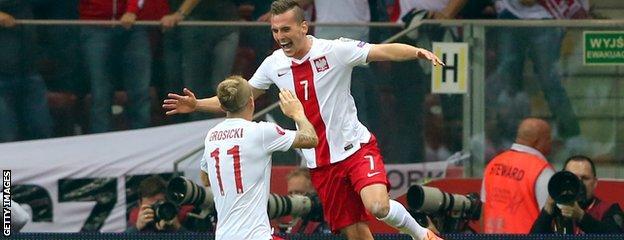 Arkadiusz Milik (right)