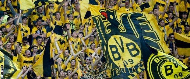 Dortmund fans cheer on their team