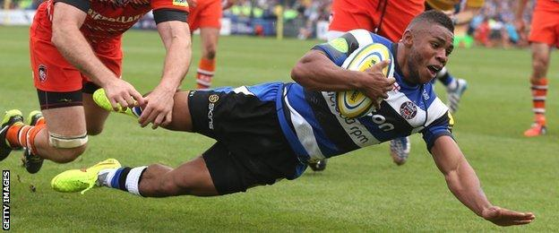 Kyle Eastmond dives over to score for Bath against Leicester