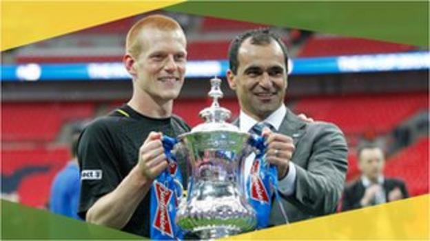 Wigan Athletic's Ben Watson and Roberto Martinez lift the 2013 FA Cup