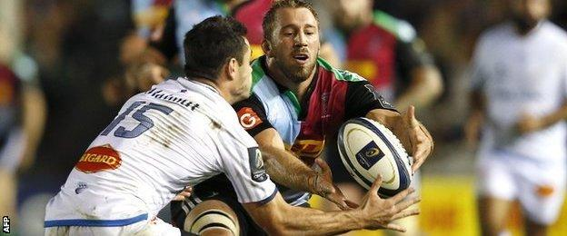 Harlequins captain Chris Robshaw competes with Geoffrey Palis of Castres for the ball