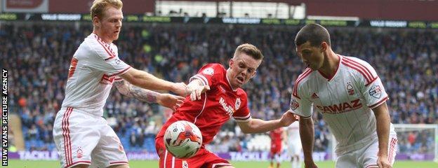 Cardiff's Craig Noone battles with Forest's former Bluebirds midfielder Chris Burke