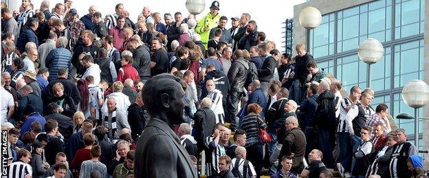 Home fans wait outside St James' Park