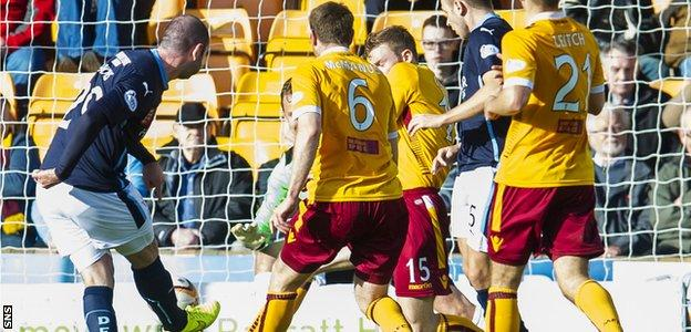 Gary Harkins nets Dundee's second goal of the game in the 3-1 triumph over Motherwell