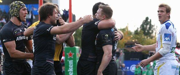 Chris Ashton is mobbed by his team-mate after scoring his second try against Clermont