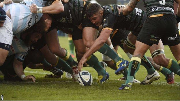 Northampton flanker Calum Clark can't resist using his hand as the ball squirts out of a scrum on Saturday