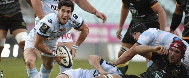 Maxime Machenaud passes the ball from the base of a ruck for Racing Metro