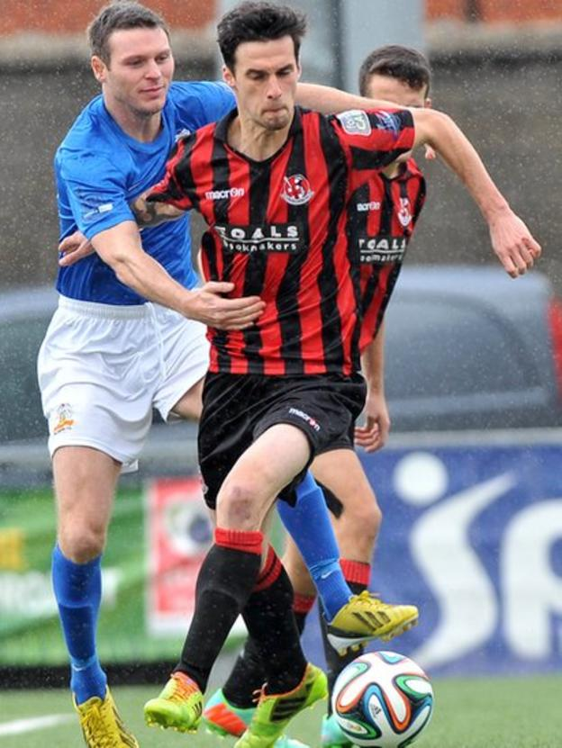 Kevin Braniff, who scored twice in Glenavon's away win over Crusaders, challenges Declan Caddell