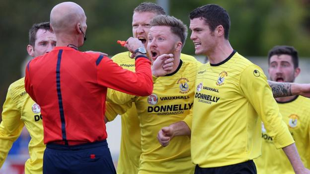 Dungannon Swifts players protest to referee Colin Burns after a penalty decision