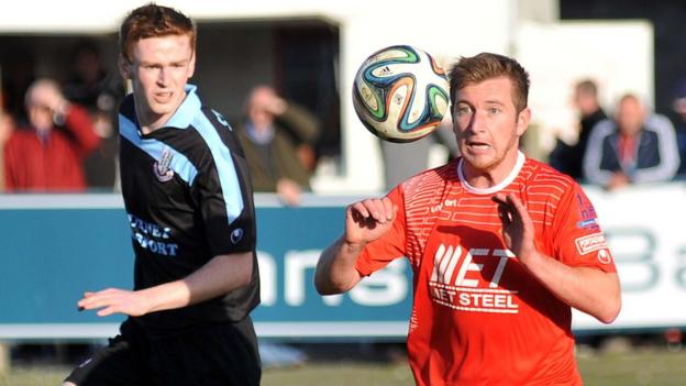 Aaron Stewart of Ballymena United in action against Portadown's Mark McAllister