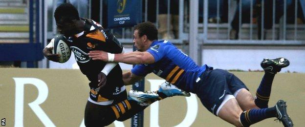 Christian Wade evades the despairing dive of Zane Kirchner to score for Wasps in their Champions Cup defeat by Leinster