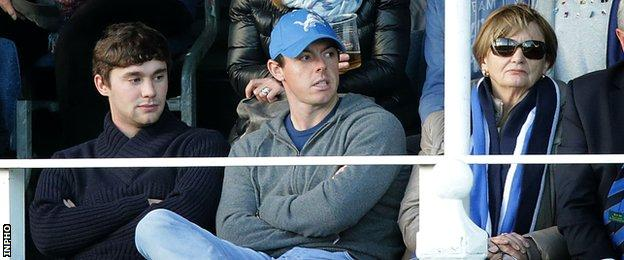 Rory McIlroy (centre) watches Leinster's win over Wasps in Dublin on Sunday